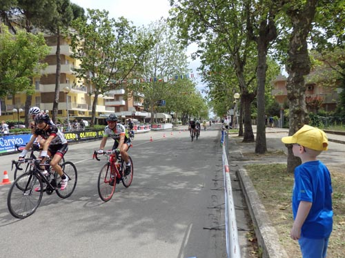 More cyclists finishing the Nove Colli