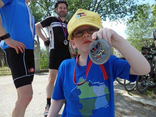 Sammie's eldest son with Grandad's medal (Jon's medal)