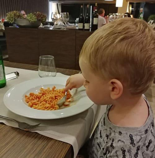 Toddler enjoying gluten free and milk free pasta