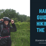 Hiker in the rain smiling at the camera