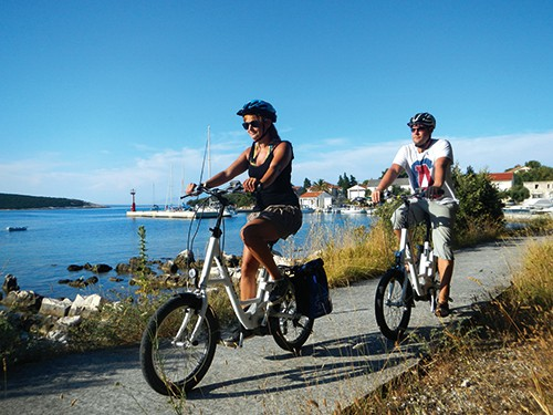 Man and Lady on an E-Bike cycling holiday