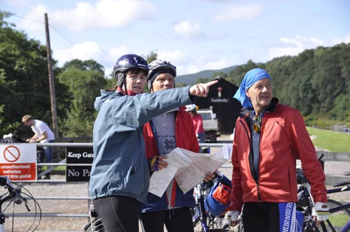 group of cyclists looking at a map