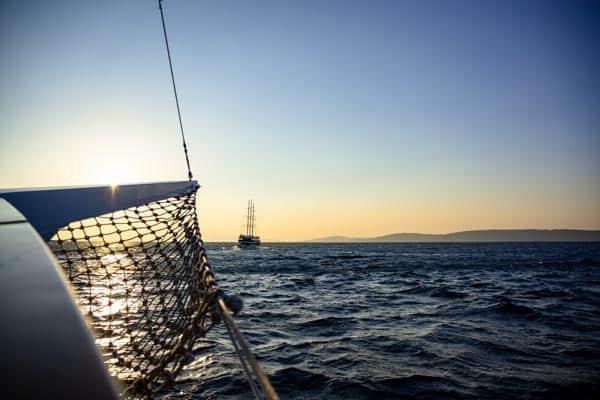 Boat sailing at sunset