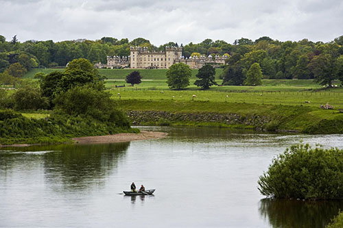Fishing from a rowing boat on the Junction Pool angling beat on the River Tweed, with Floors Castle visible beyond, Scottish Borders. Picture Credit : P. Tomkins / VisitScotland / Scottish Viewpoint Tel: +44 (0) 131 622 7174 E-Mail : info@scottishviewpoint.com This photograph can not be used without prior permission from Scottish Viewpoint.