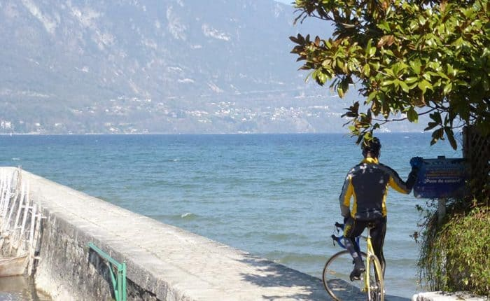 Cyclist overlooking the Lake on his bike